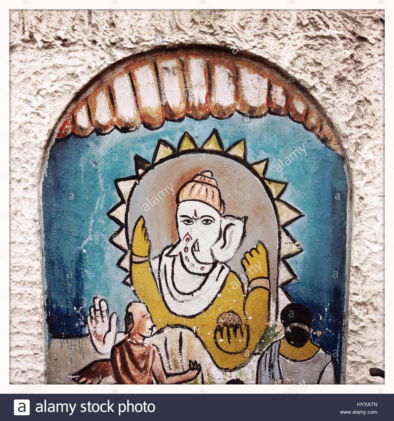 A painting of the Hindu deity, Ganesh, outside a school on the streets of Kolkata. - Stock Image