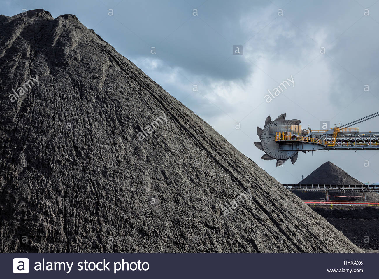 An automated bucket-wheel excavator loads coal into ships bound for China and India. Stock Photo