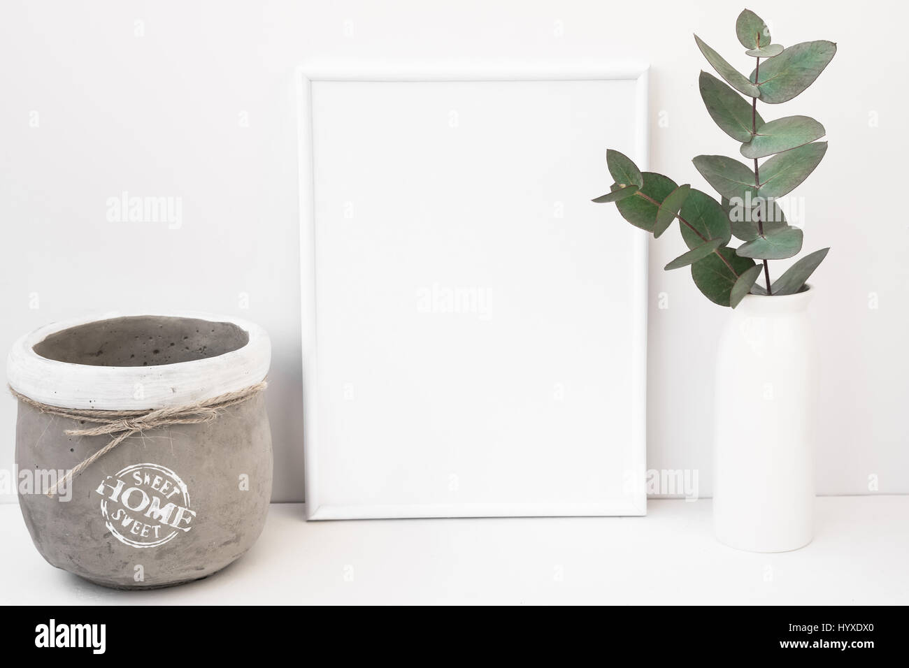 White background frame mockup, green eucalyptus in ceramic vase, cement pot, styled image for social media, product - Stock Image