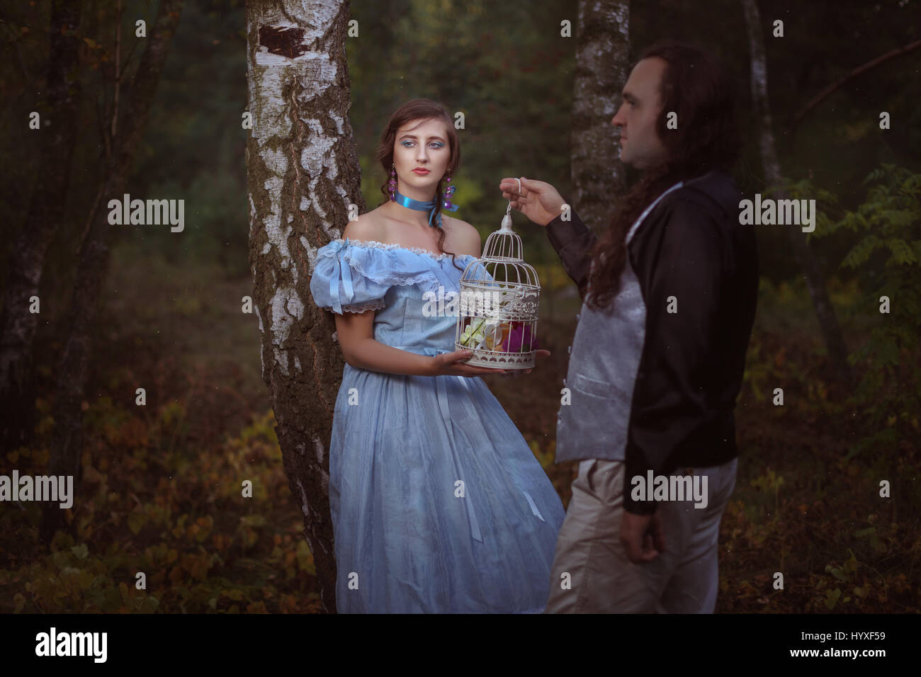 Old man makes a gift to a young woman. - Stock Image