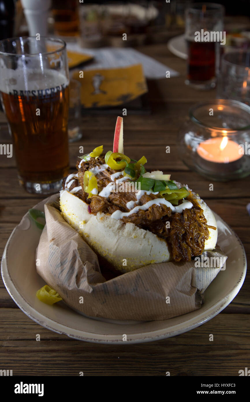 Pulled pork sandwich served at the Altes Maedel restaurant in Hamburg, Germany. The restaurant is within the Ratsherrn - Stock Image
