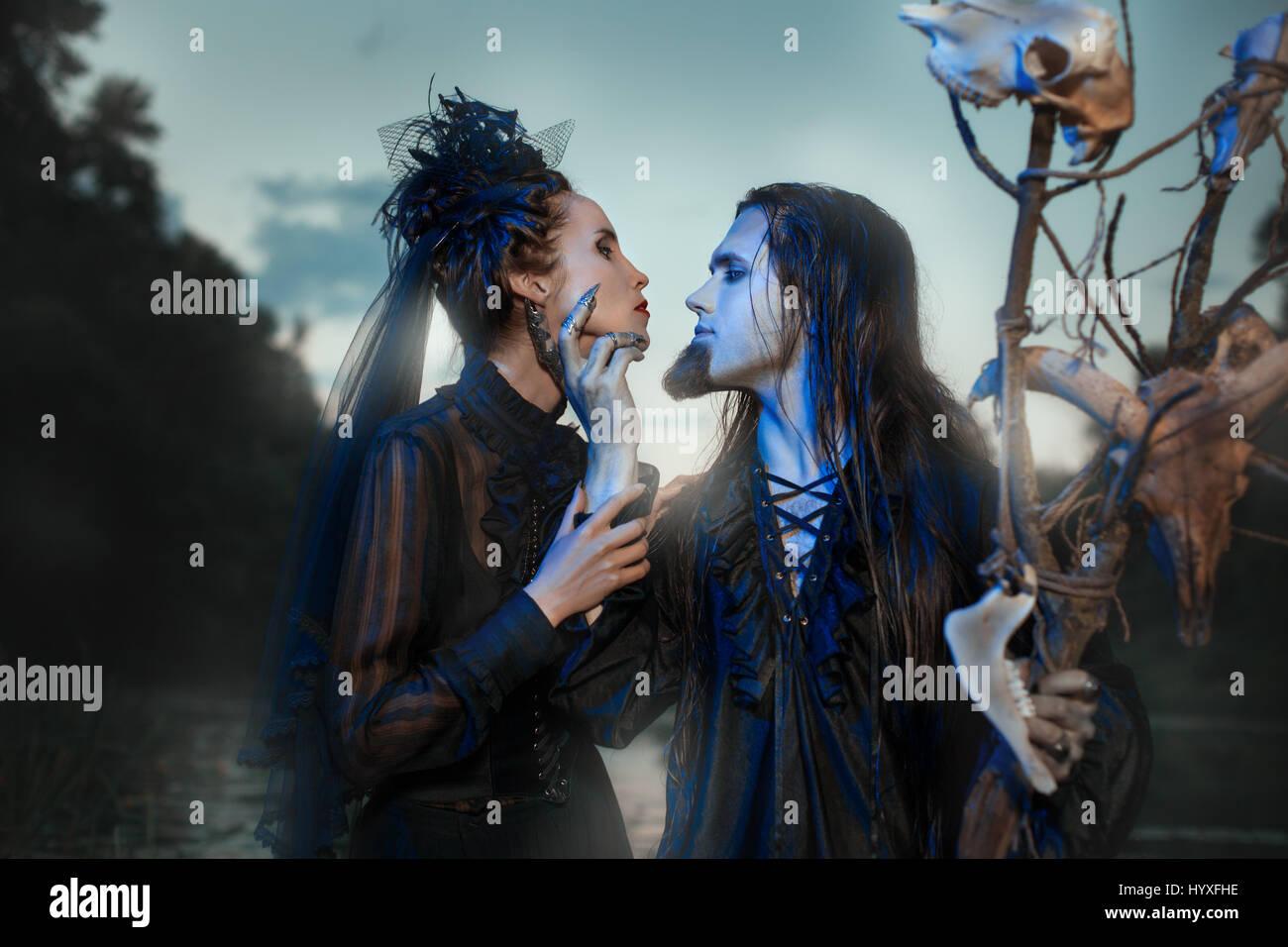 Creepy people conjure night, they look like demons. - Stock Image