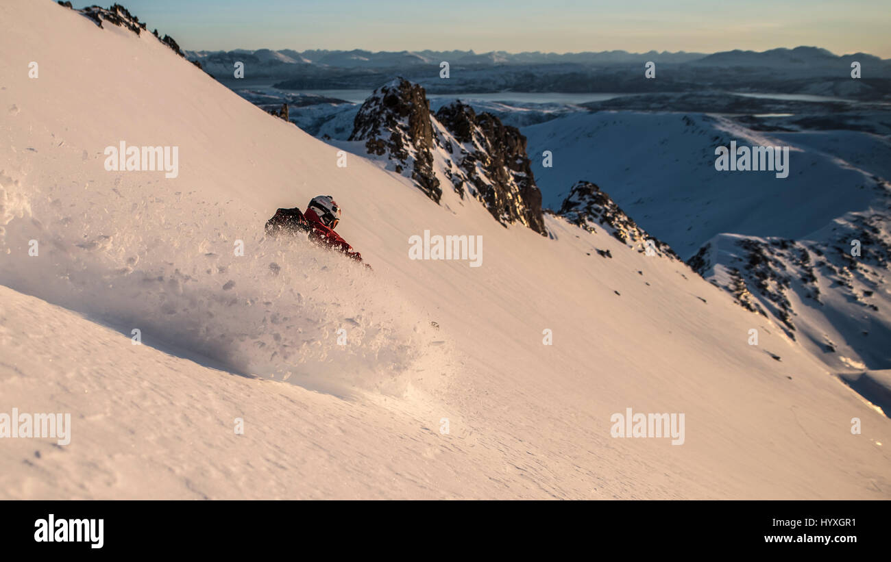 Off piste skier in Northern Norway (Senja) in the early morning - Stock Image