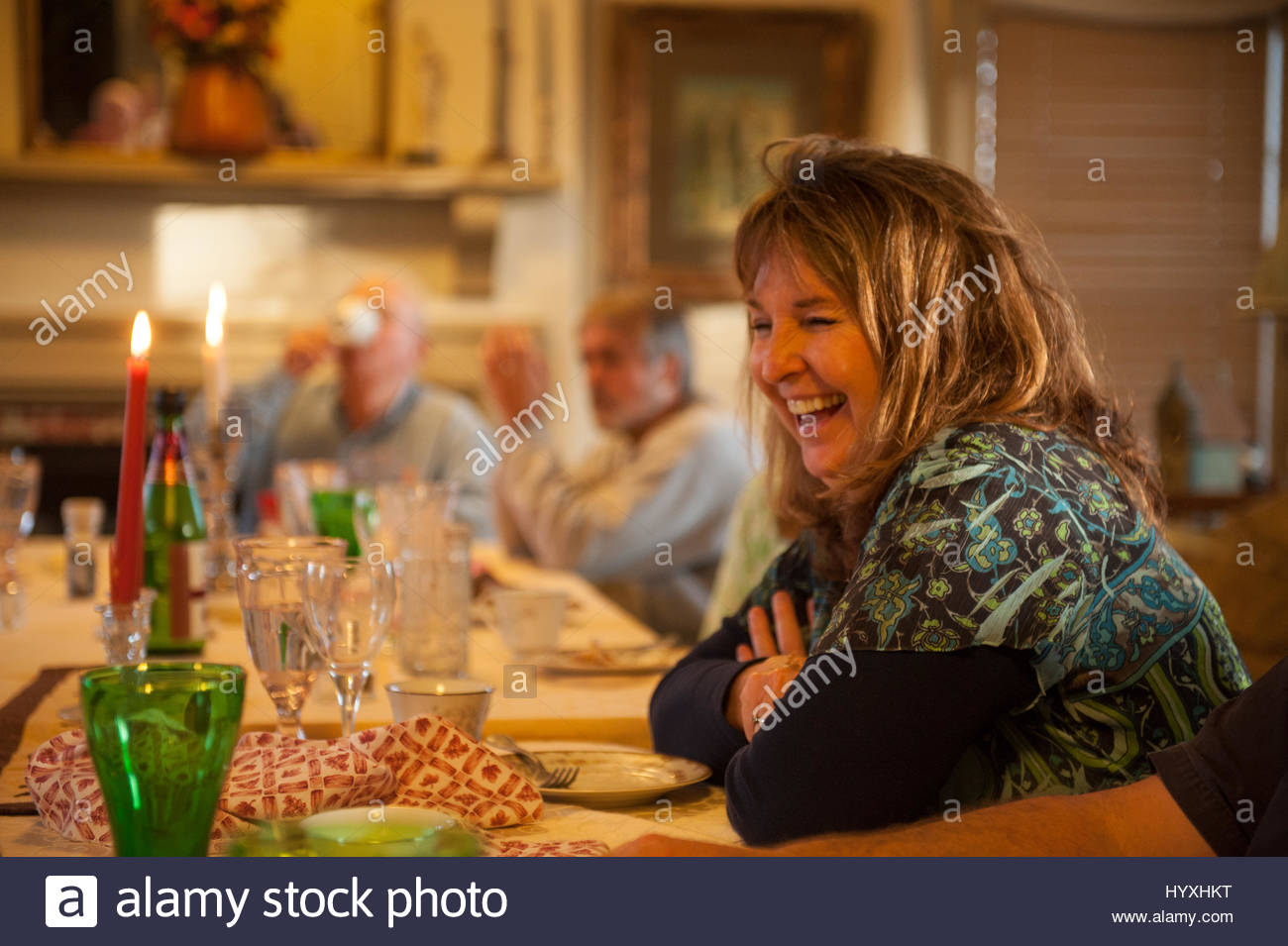 A family has a good time at their Thanksgiving meal. - Stock Image