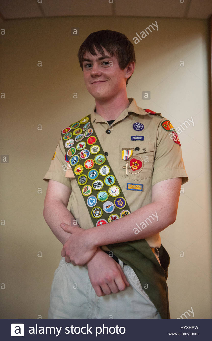 A teenage boy is awarded the rank of Eagle Scout. - Stock Image
