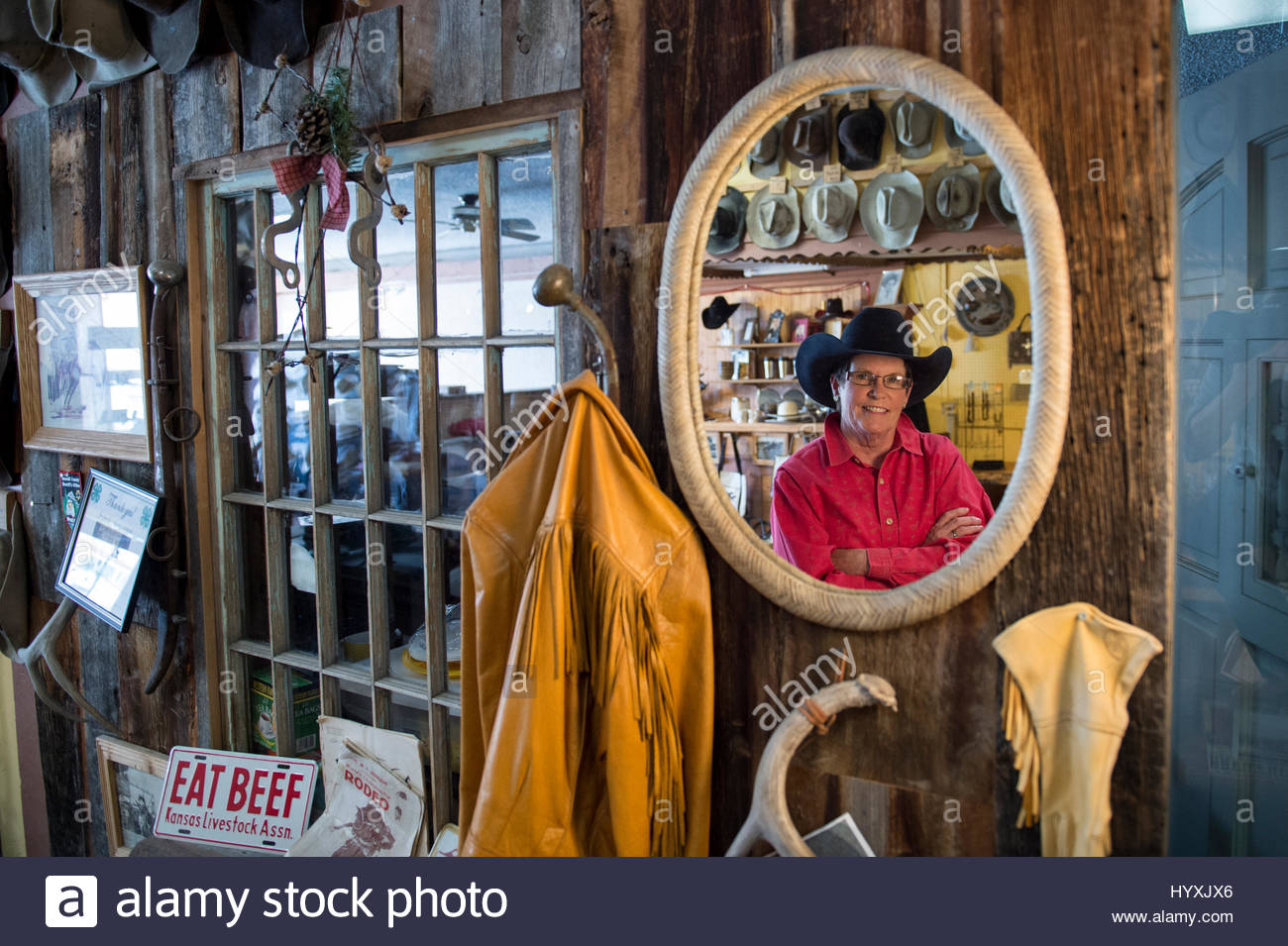 A hat maker shows off her famous creations in Twin Bridges, Montana. - Stock Image
