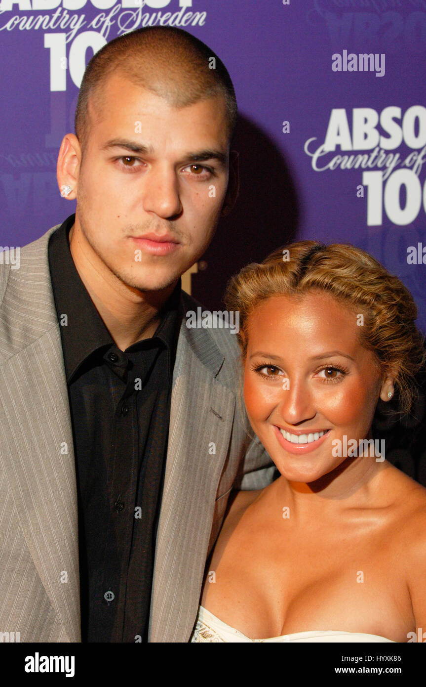 Television personality Rob Kardashian (L) and singer Adrienne Bailon arrives at the #|#Glow in the Dark Tour 2008#|# - Stock Image