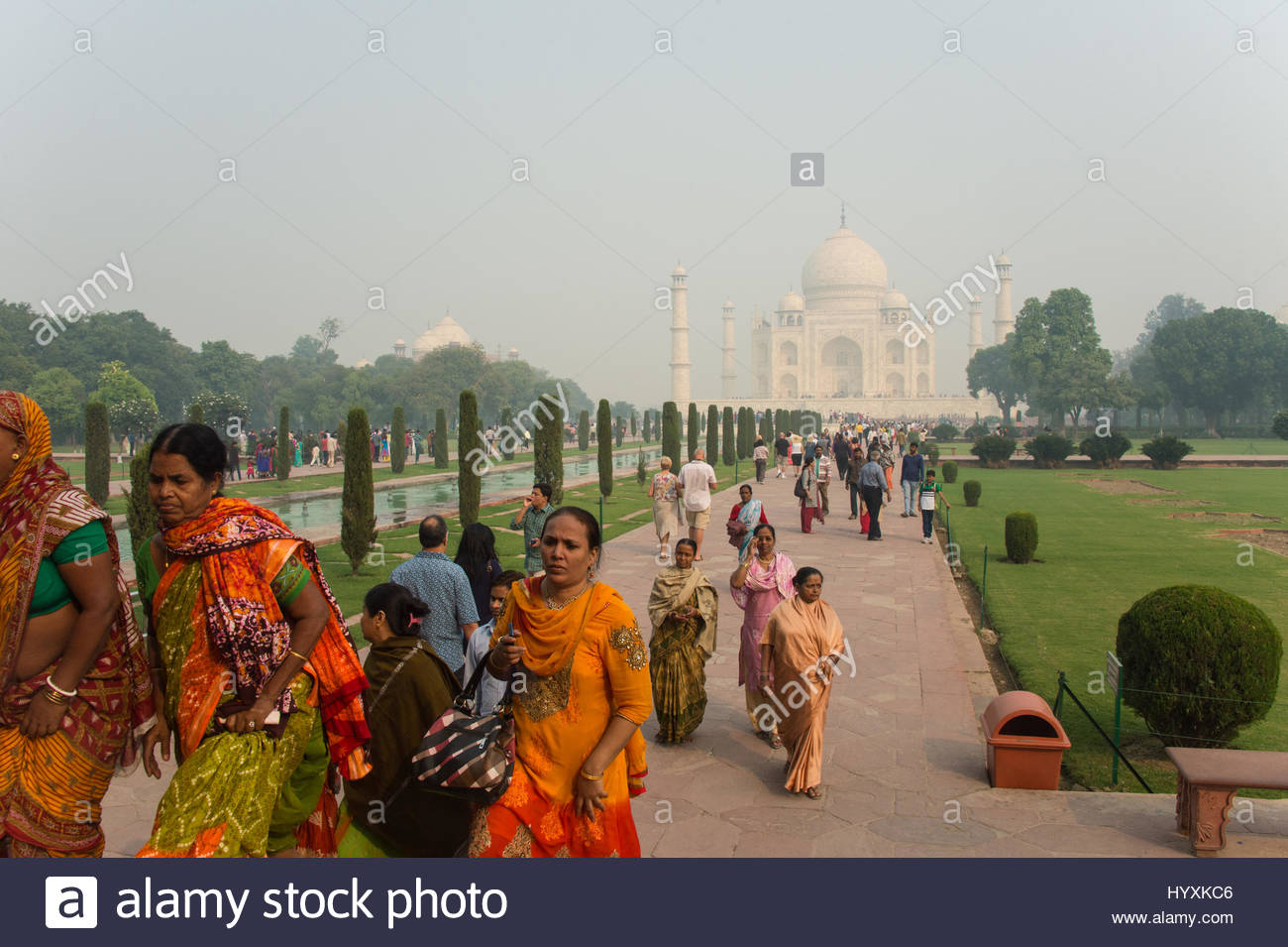 Tourists visit the Taj Mahal in Agra, Uttar Pradesh, India. - Stock Image