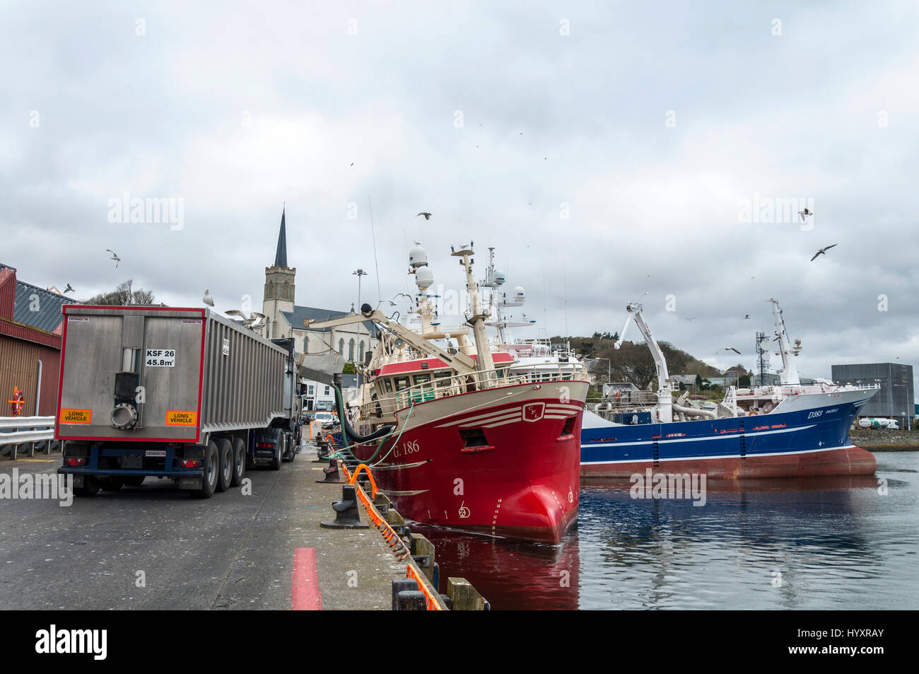 Unloading a fishing trawler boat in Killybegs Harbour, County Donegal, Ireland - Stock Image