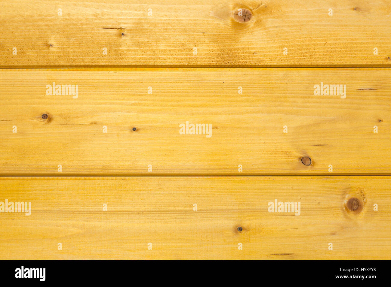 Texture of treated, stained and polished wood with natural spots, scars and marks - Stock Image