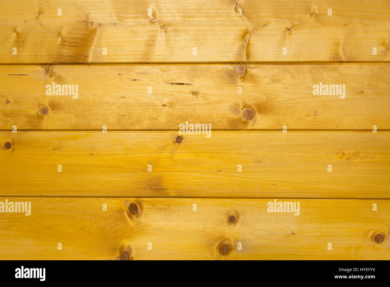 Abstract texture of treated, stained and polished wood with natural spots, scars and marks - Stock Image