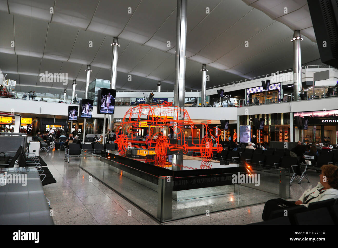 England Heathrow Airport Terminal Two Departure Lounge With Art Work Of A London Taxi - Stock Image
