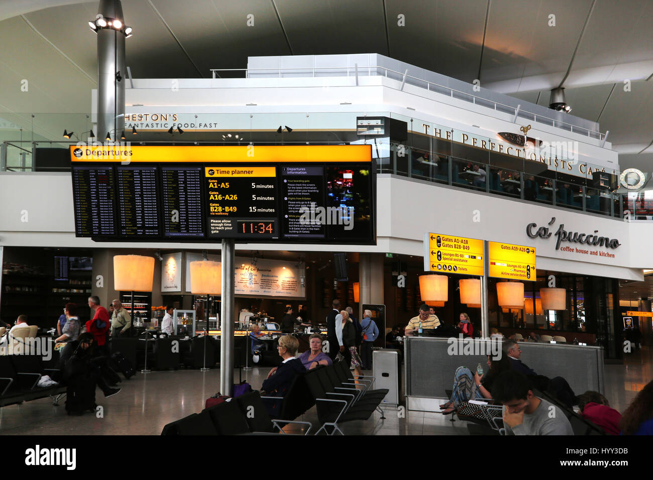 England Heathrow Airport Terminal Two Passengers Waiting In Departure Lounge And Restaurants - Stock Image