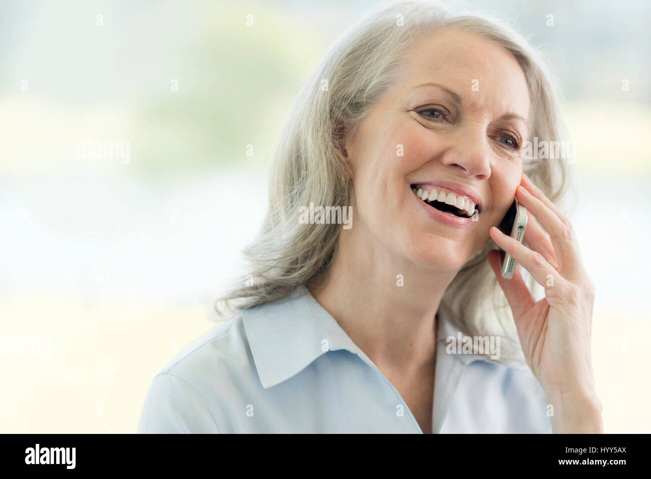 Senior woman on cell phone. - Stock Image