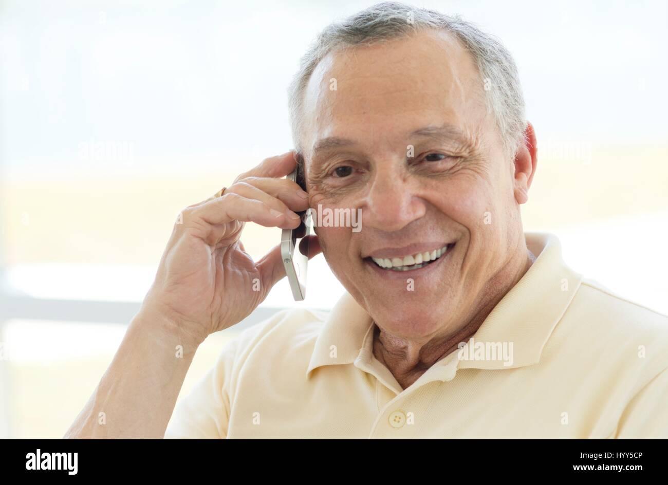 Senior man on cell phone. - Stock Image