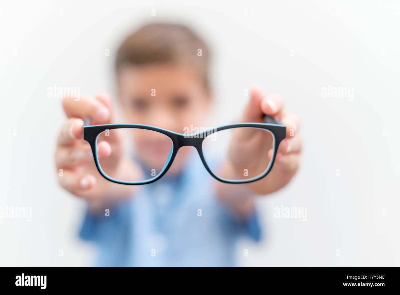 Boy holding glasses close up. - Stock Image