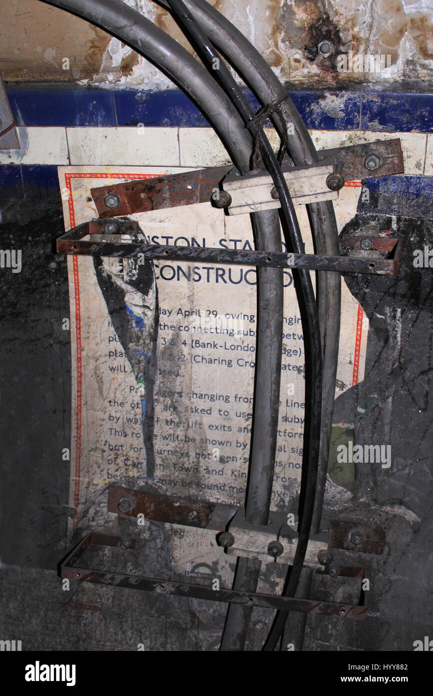 Euston Underground station. Old LT poster in disused passage. HAUNTING pictures have revealed the long-forgotten - Stock Image
