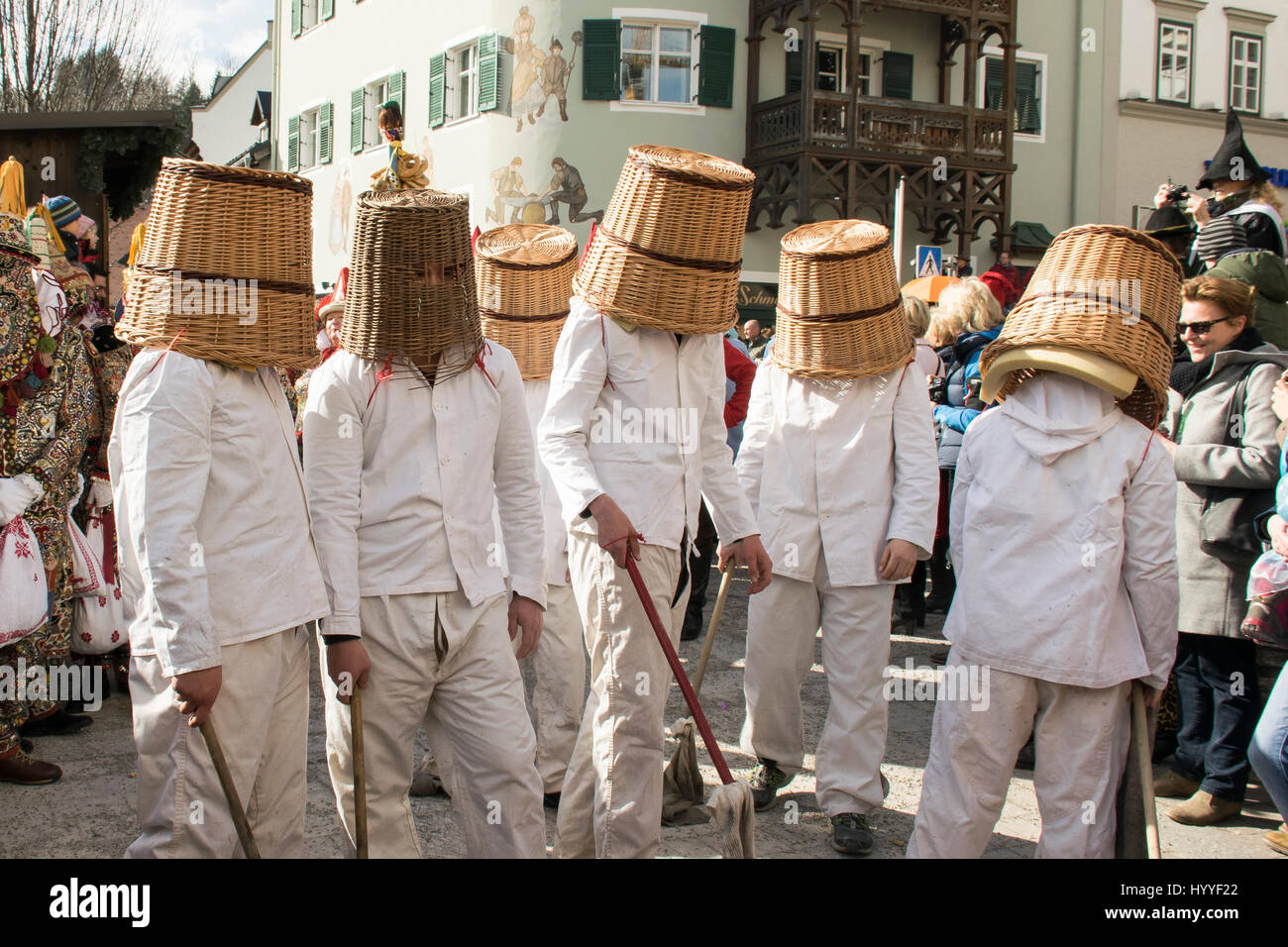 Aussee Carnival, men in white suits, even Pless, woven baskets on heads, Bad Aussee, Styria, Austria - Stock Image