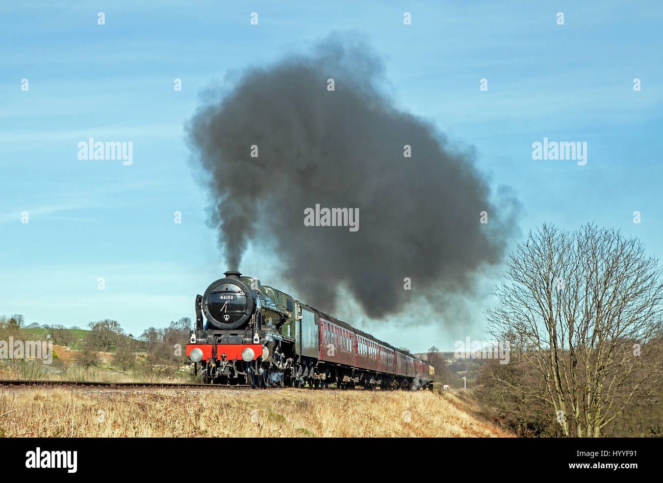 46100 'Royal Scot' makes a dramatic sight passing Moorgates with the very first train at the North Yorkshire - Stock Image