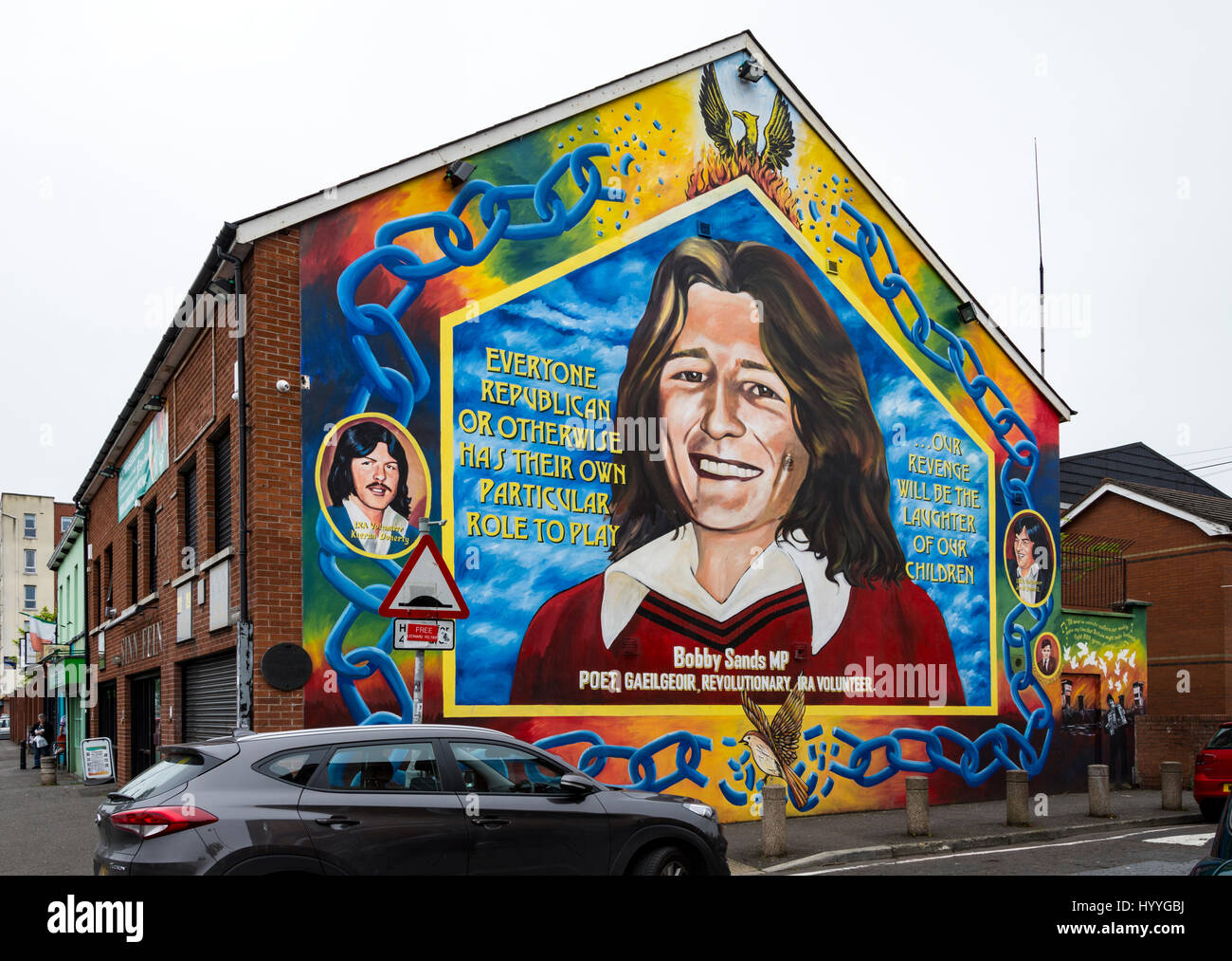Wall mural depicting Bobby Sands, on the side of the Sinn Féin office, Falls Road, Belfast, County Antrim, - Stock Image