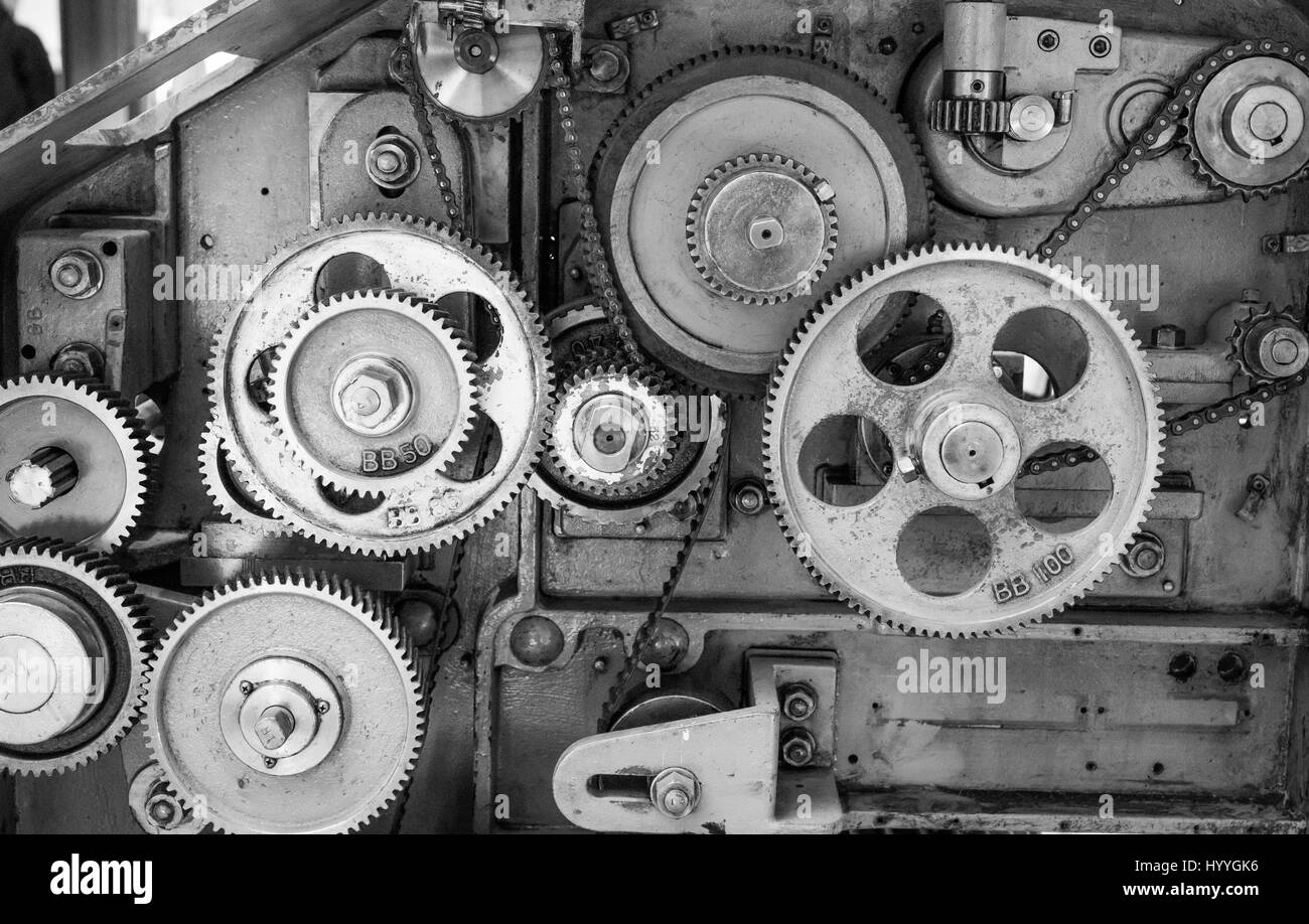 Gears inside a vintage textile machine used to produce wool and other textile products. - Stock Image