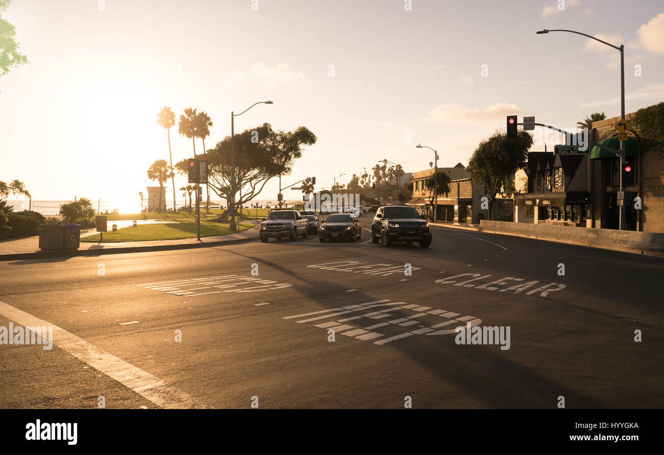 Pacific Coast Highway cutting through the coastal city of Laguna Beach in Orange County. - Stock Image
