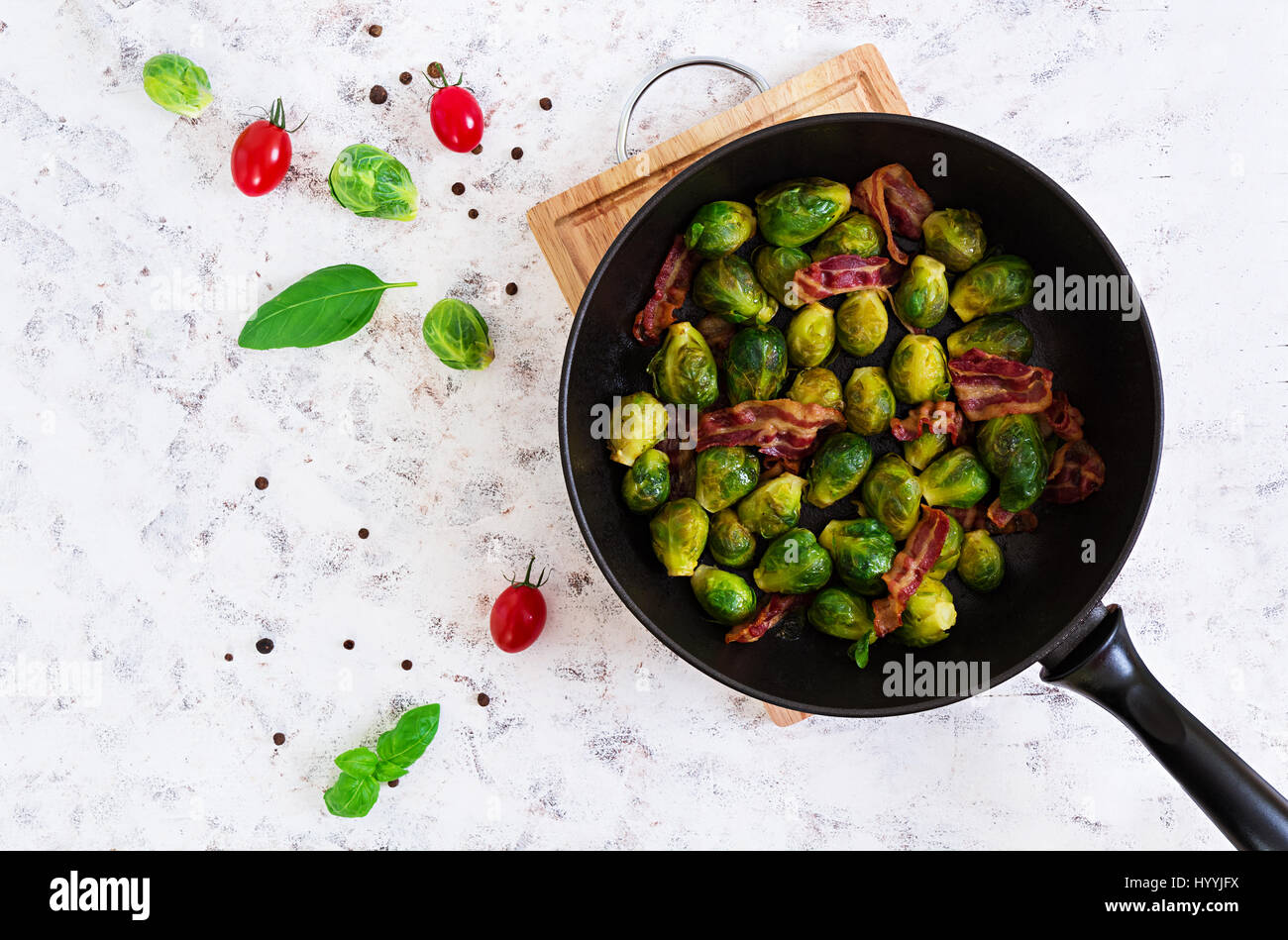 Roasted brussels sprouts with bacon on white background. Top view Stock Photo