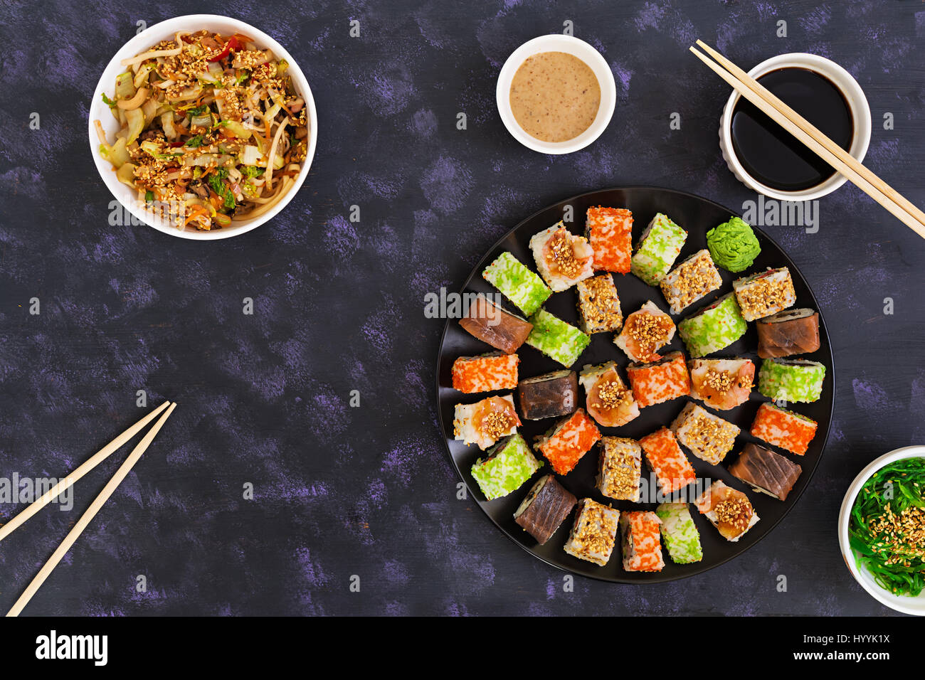 Sushi roll on dark background. Top view - Stock Image