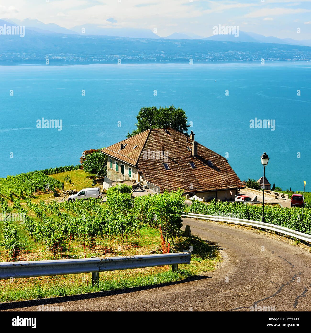 Road leading to Lavaux Vineyard Terraces hiking trail, Lake Geneva and Swiss mountains, Lavaux-Oron district, Switzerland Stock Photo