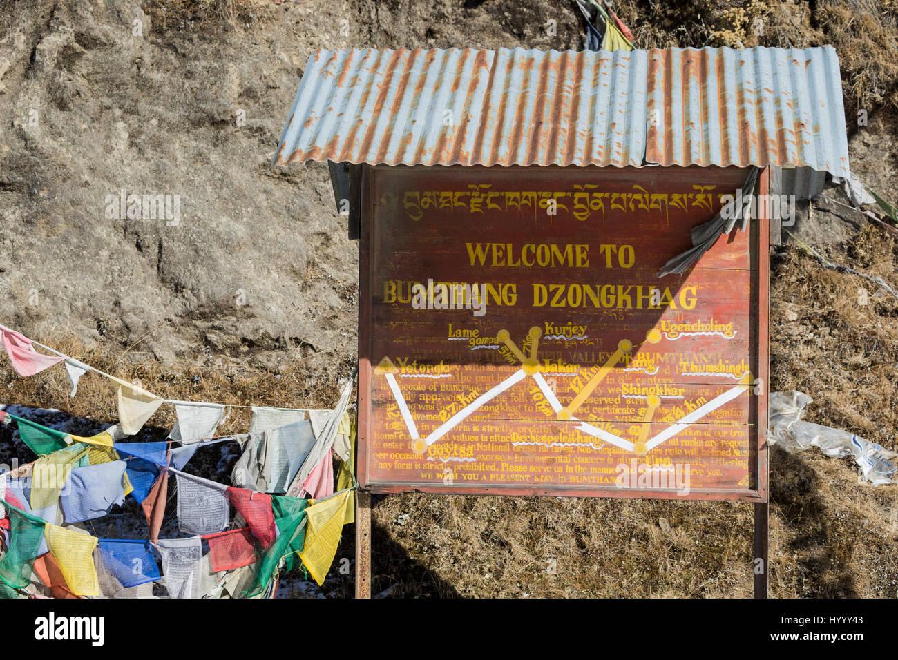 Bumthang Dzonghag sign with prayer flags (Bhutan) - Stock Image