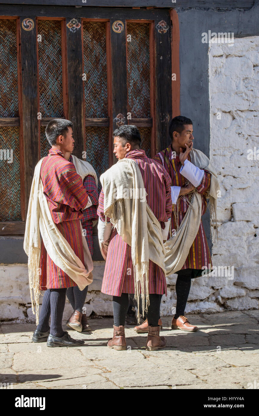 Men wearing the traditional Gho robe at Trongsa Tsechu (Bhutan) Stock Photo