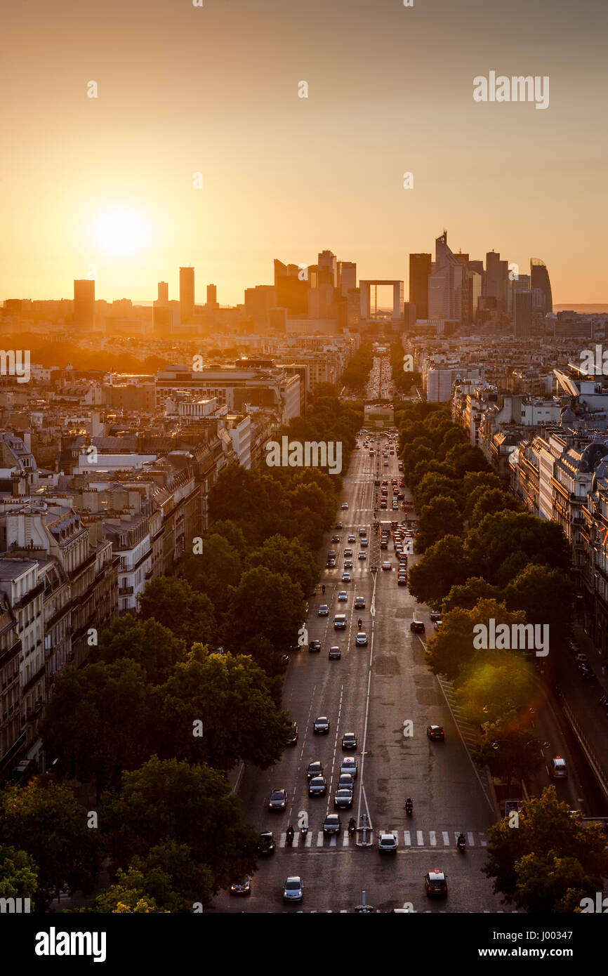Summer sunset on Avenue de la Grande Armee and La Defense neighborhood in Paris. 16th and 17th Arrondissements, Stock Photo