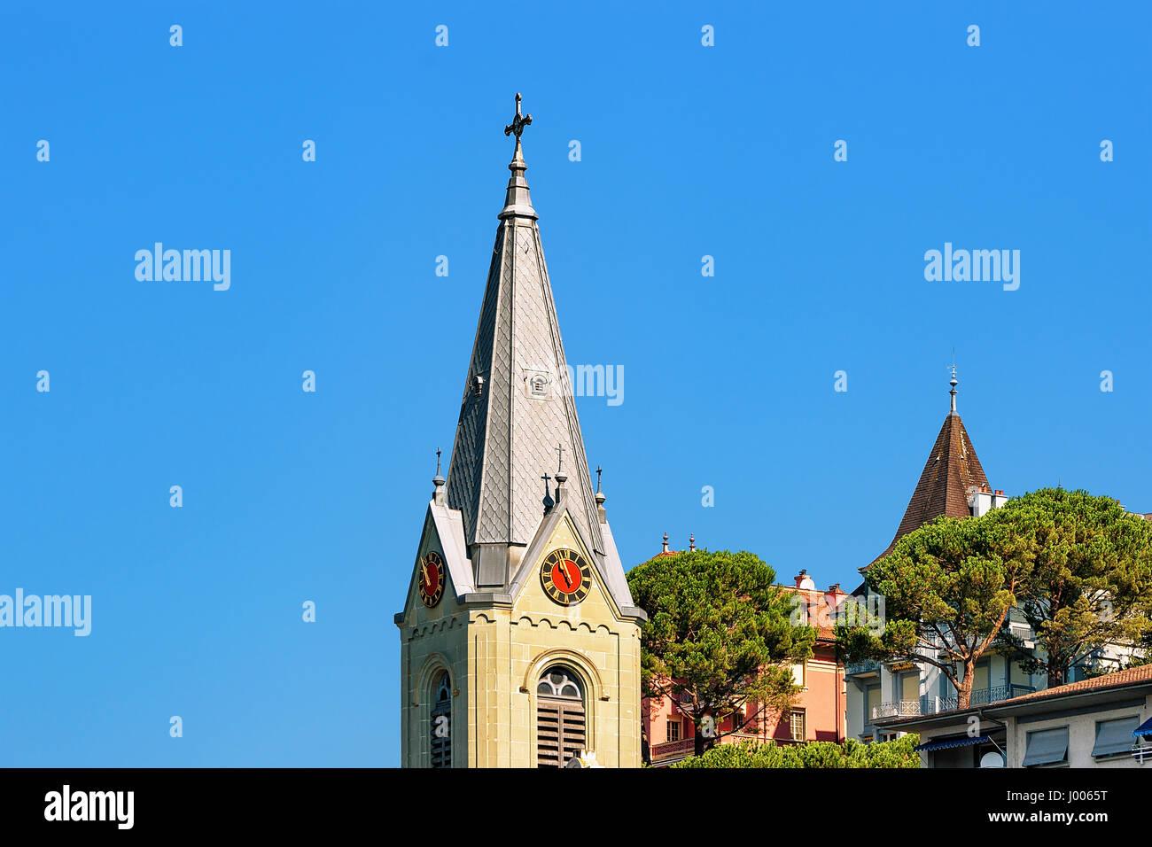 Church clock tower at Geneva Lake Riviera in Montreux, Vaud canton, Switzerland - Stock Image