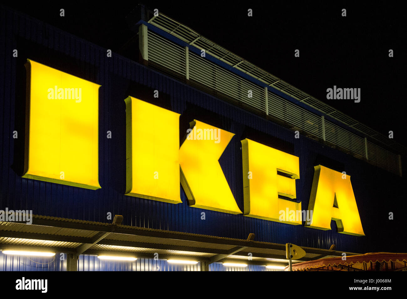Large yellow, neon Ikea store sign outside Wembley superstore, London, UK - Stock Image