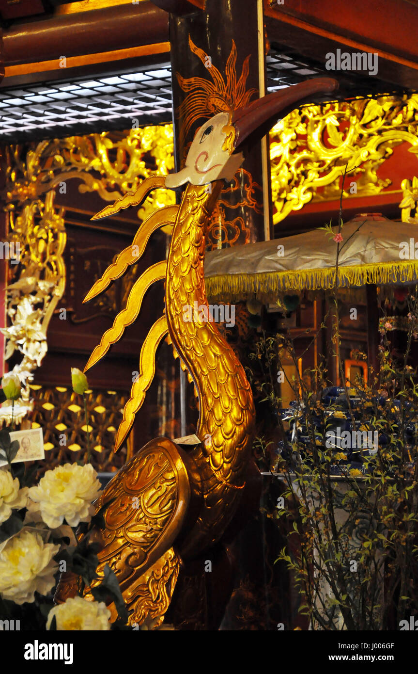 HANOI, VIETNAM - FEBRUARY 19, 2013: The golden interior of the Bach ma temple in Hanoi was decorated in the Medieval Stock Photo
