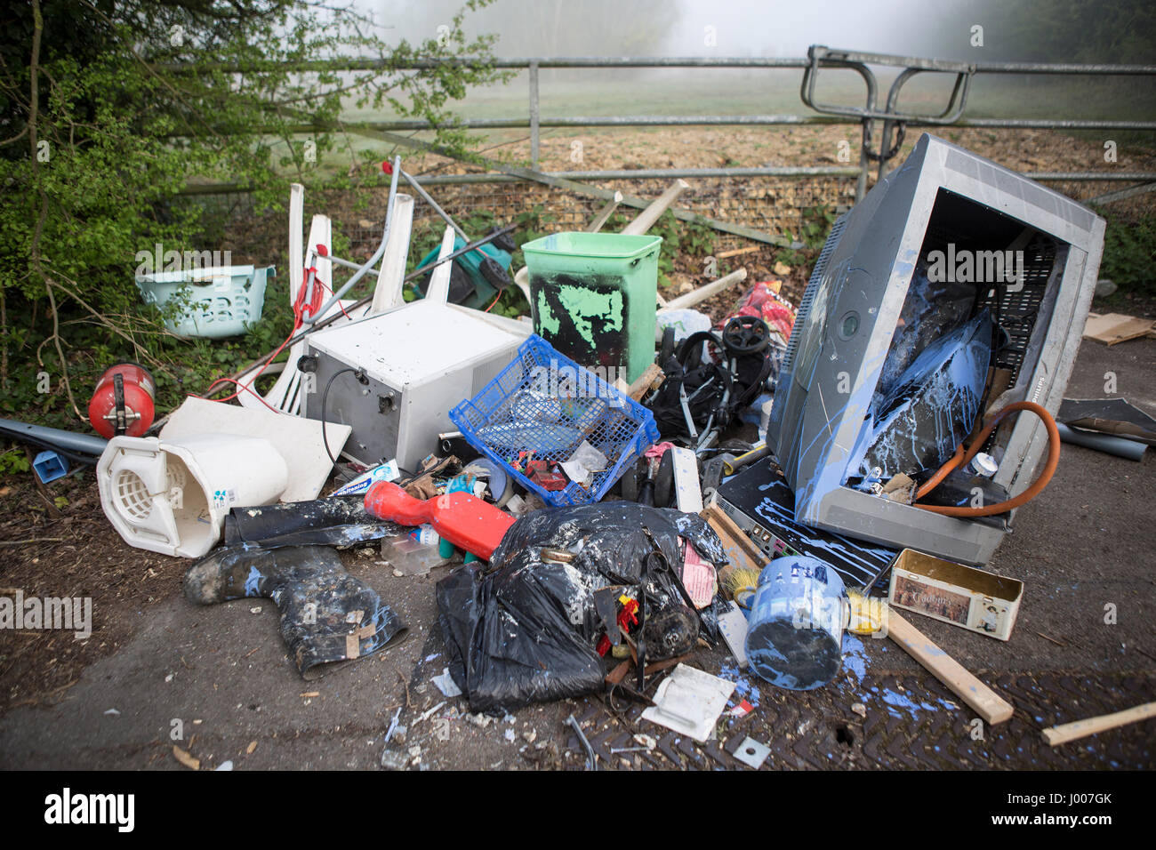 Waste dumped in the Wiltshire countryside, an illegal social issue, fly tipping causing environmental pollution - Stock Image