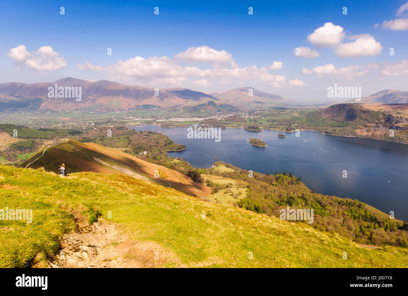 Keswick, England - April 19, 2009: A climber on Catbells mountain stops to admite the view of forests and fields - Stock Image