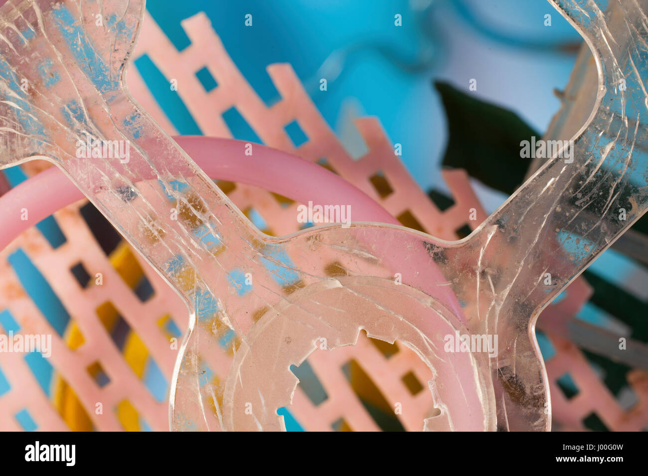 Macro composition of various bits of plastic trash - Stock Image
