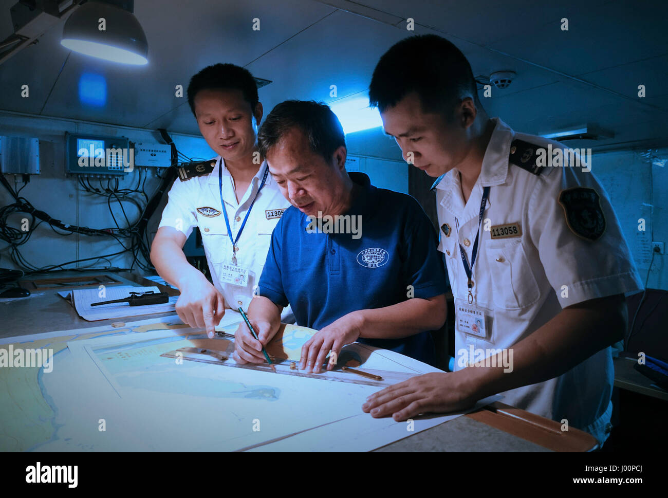 Sanya, China's Hainan Province. 8th Apr, 2017. Workers of Sanya Maritime Safety Administration and captain of - Stock Image