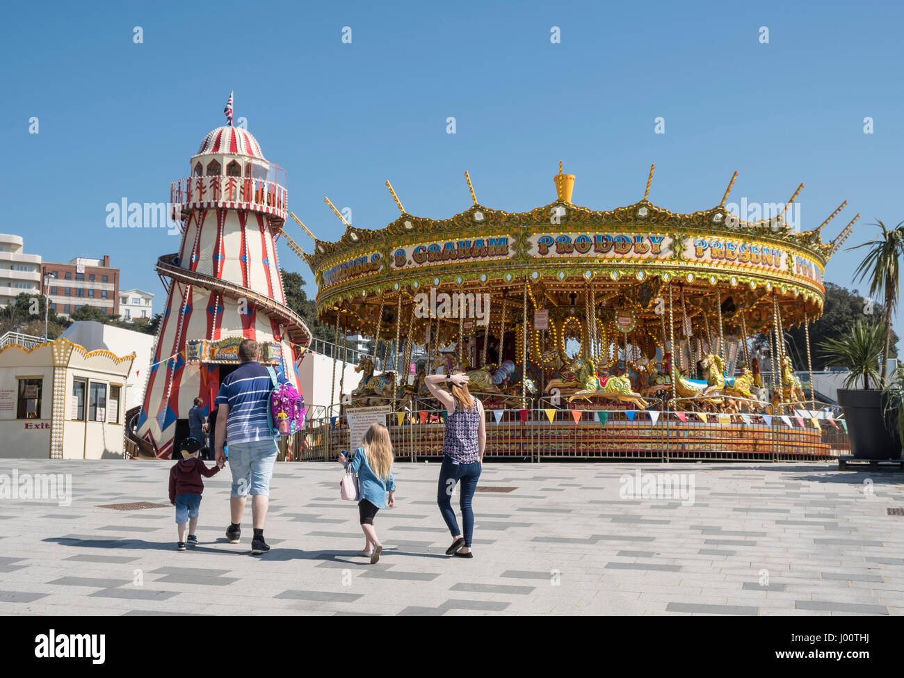 Merry-go-round or Carousel and Victorian Helter-skelter Spiral Slide for children in Bournemouth, Dorset, UK Stock Photo