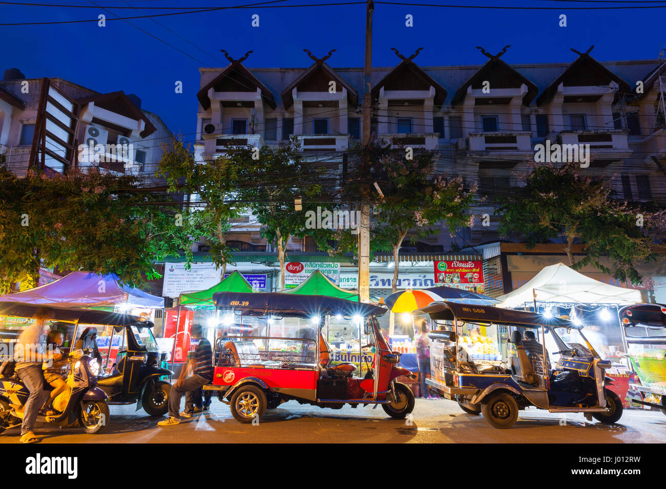 Chiang Mai, Thailand - August 21, 2016: Tuk-tuk taxis wait for customers near Saturday Night Market on August 21, Stock Photo