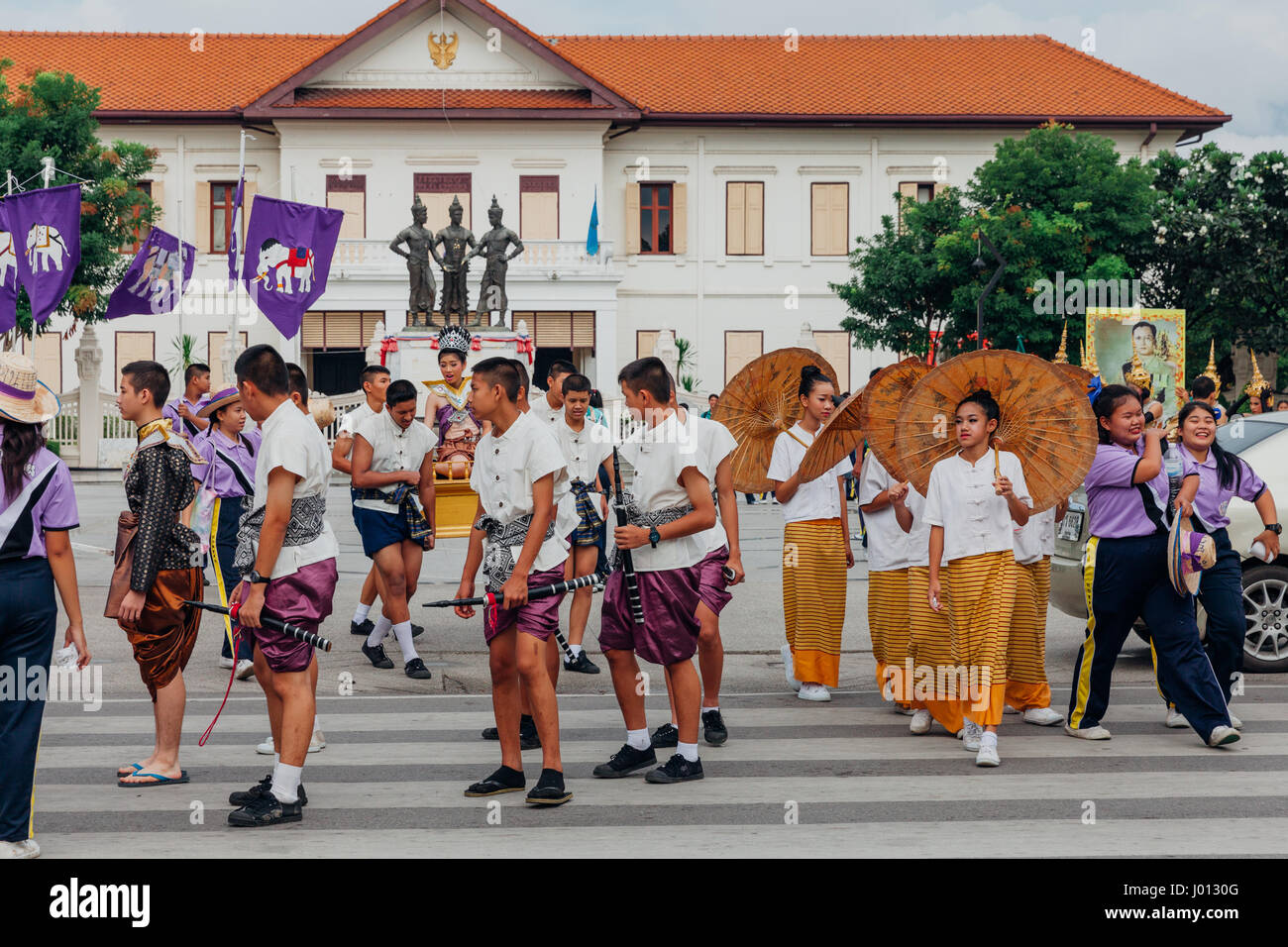 Chiang Mai, Thailand - August 24, 2016: Young boys and girls in festival costumes parade near the Three Kings Monument - Stock Image