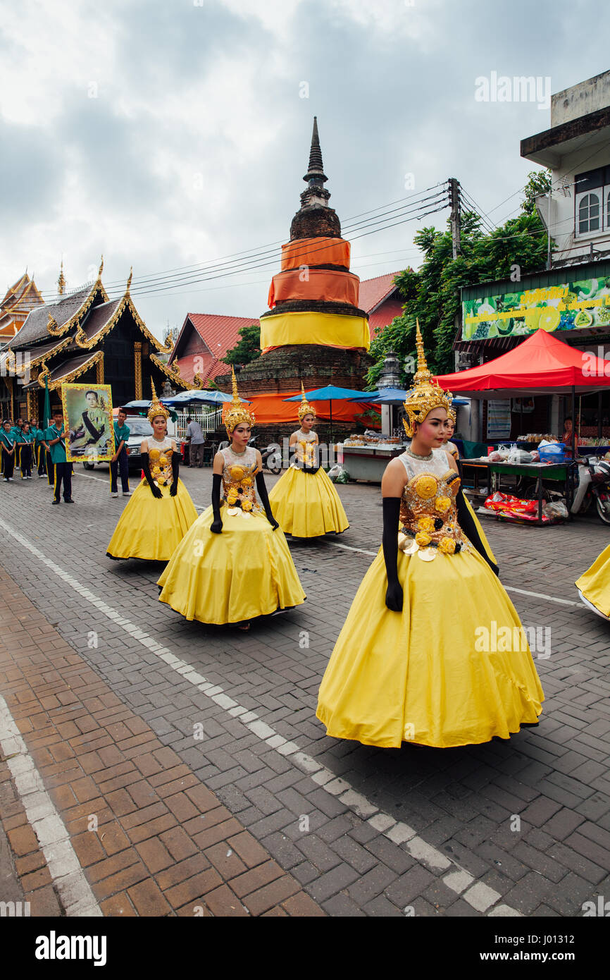 Chiang Mai, Thailand - August 24, 2016: Young girls in festival costumes parade near the ancient temple on August - Stock Image