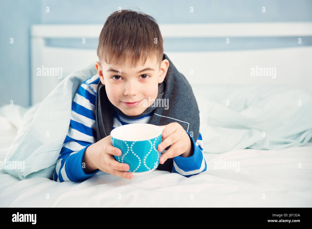 Sad boy bed stock photos sad boy bed stock images alamy ill boy lying in bed stock image altavistaventures Images