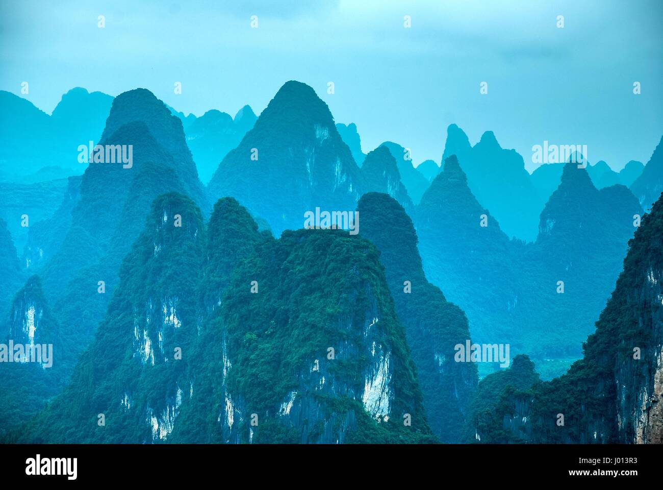 Karst mountains rural scenery in the mist, Guilin, China. - Stock Image