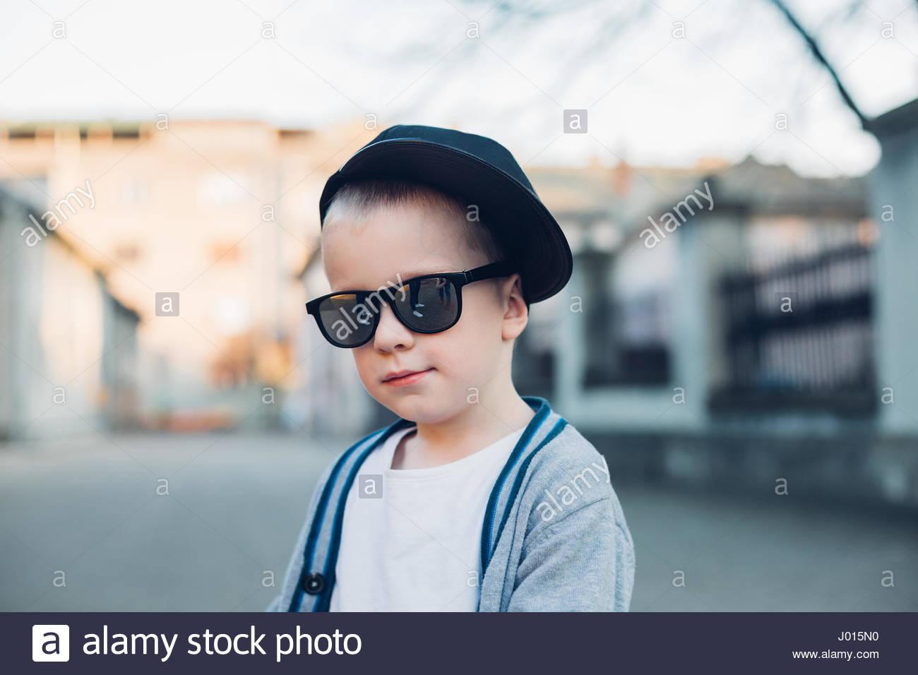 58974931125e Cool kid - super cute kid wearing sunglasses Stock Photo: 137709404 ...
