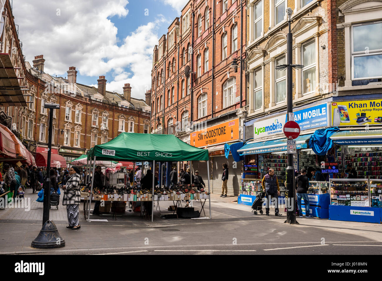 Electric Avenue, Brixton, London. Built in the 1880s, it was the first market street to be lit by electricity. Today, - Stock Image