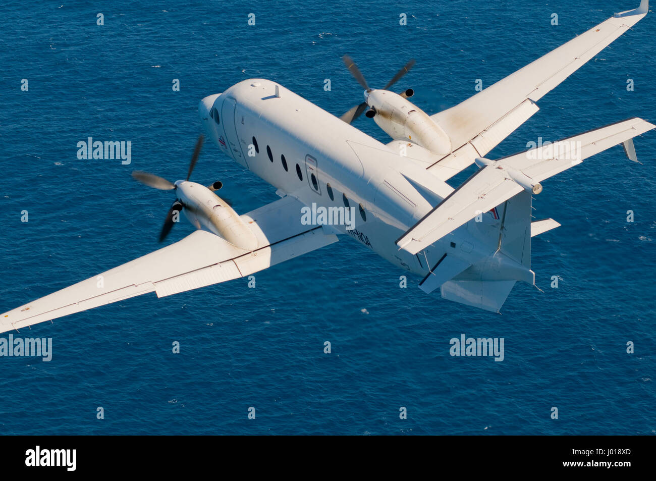 An aerial view of a Beechcraft B1900D short-haul / charter airliner. - Stock Image