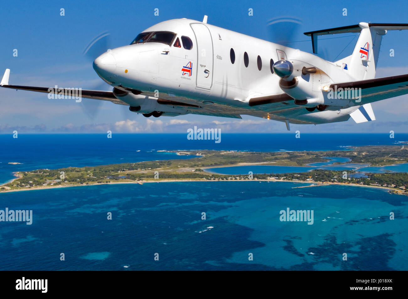 An aerial view of a Beechcraft B1900D short-haul / charter airliner leaving Rottnest Island, in Western Australia. - Stock Image