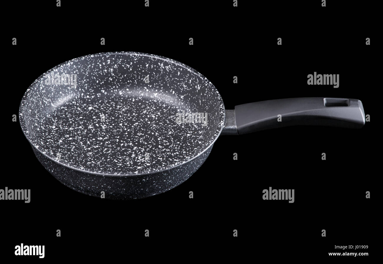 Stone Pan, angle view. Isolated on black background Stock Photo